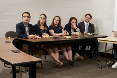 Students at a table during an ethics bowl competition