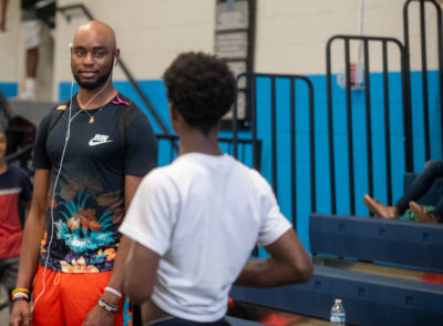 Quintin Coe talks to a teenager at Boys and Girls Club