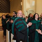Graduates clap hands in Snidow Chapel
