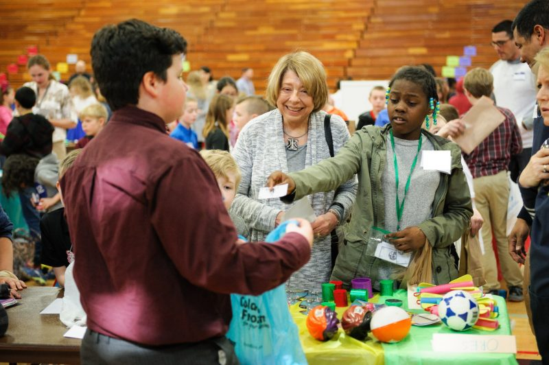 Elementary School students selling products at Market Day.