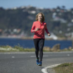 Kathrine Switzer running on a road