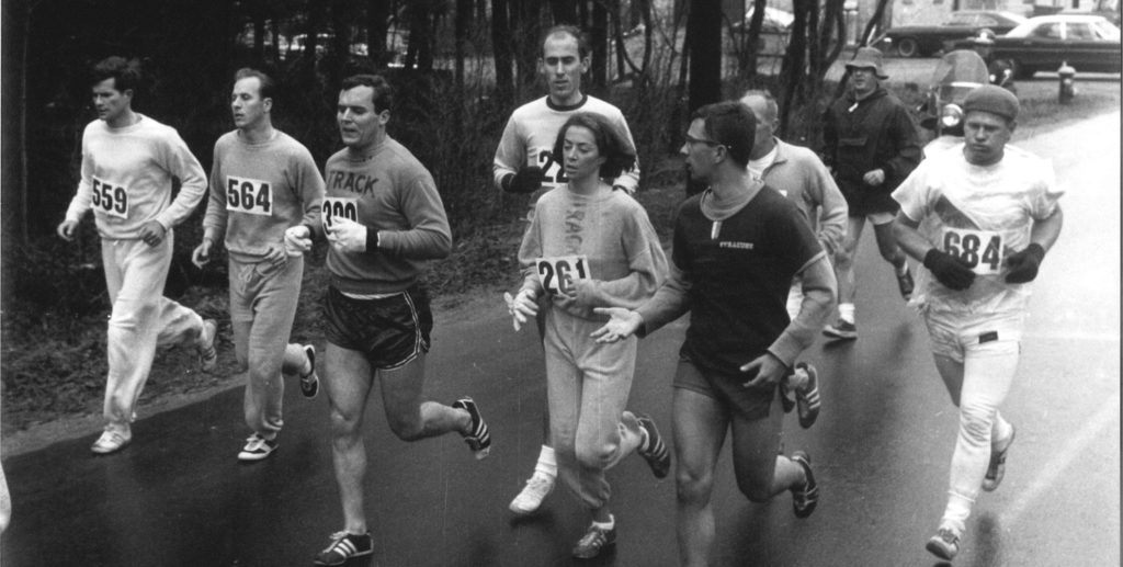 Kathrine Switzer and other runners run