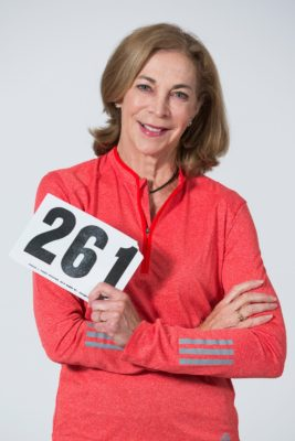 Kathrine Switzer holds a replica of a race bib number 261, the number she wore in the 1967 Boston Marathon.