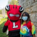 Dell the Hornet with student in mask