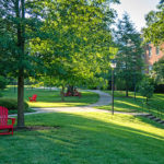 Hundley Hall in the background with red chairs in the foreground