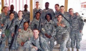 Sharon Denson DSMc with a group of fellow soldiers