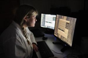 Katie Roderick examines data on computer screens