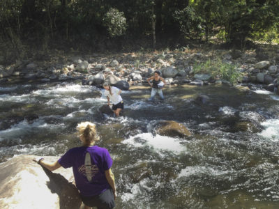 students wade into a river in Costa Rica
