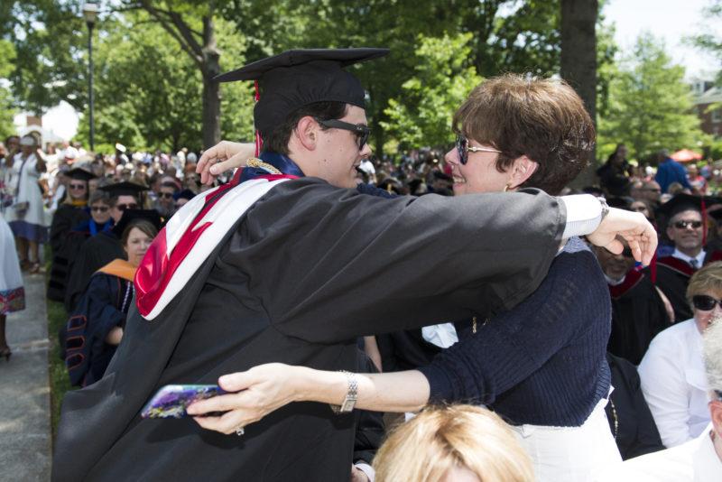 Sue Tatom hugs son Matthew at his graduation ceremony