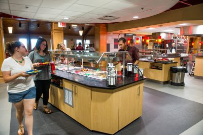 People walk through the newly renovated dining hall serving area
