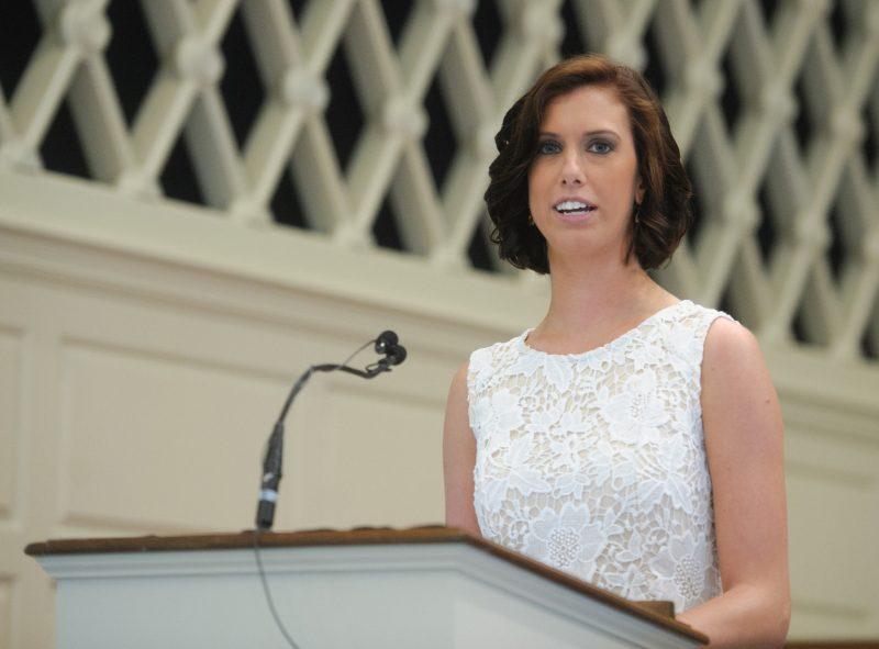 Brooke McNamara '17 PA speaking at a podium.