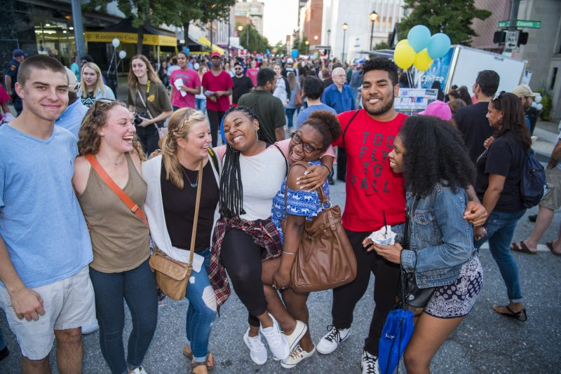 Students enjoy the Get Downtown street festival.