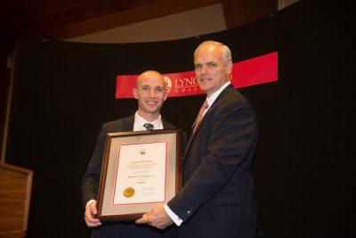 Anthony Palmisano receives his award
