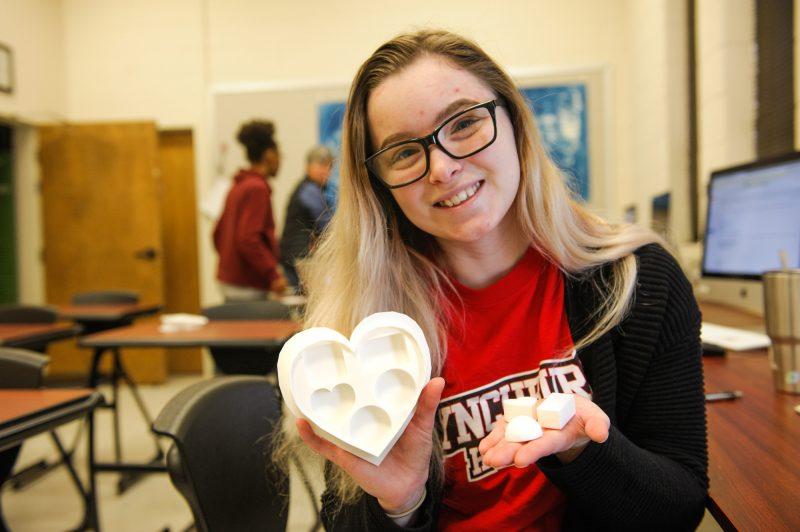 Alex Gancedo holds a 3D-printed heart
