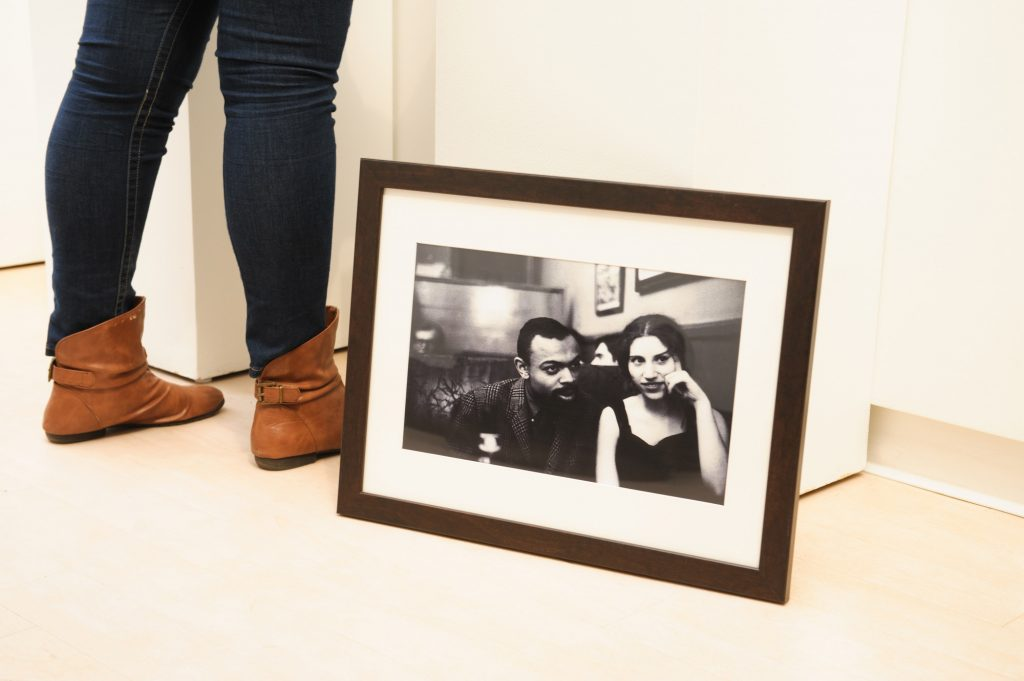 A photograph sits on the floor by Shelby Miller's feet.