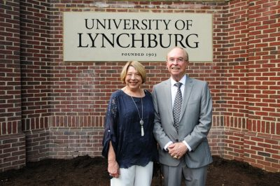 Sheila and Ken Garren in front of the new University of Lynchburg sign