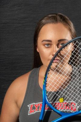 Christina Harris holding a tennis racket