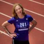Kathrine Switzer standing on the track at Shellenberger Field