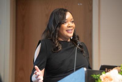 Francessca Vasquez speaking at a podium