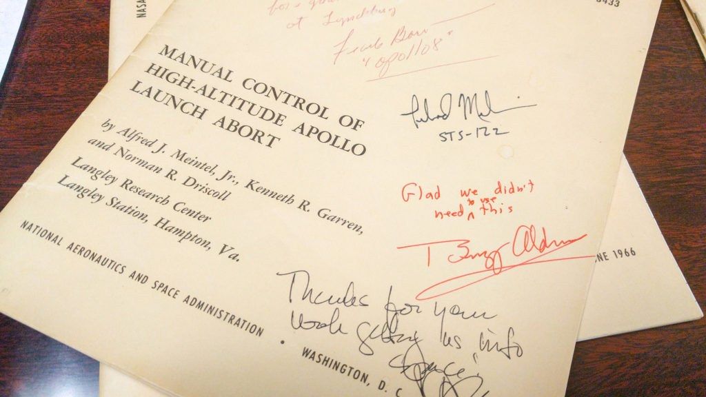 "Photo of a report written by Kenneth Garren and autographed by Buzz Aldrin, who added, ""Glad we didn't need to use this"""
