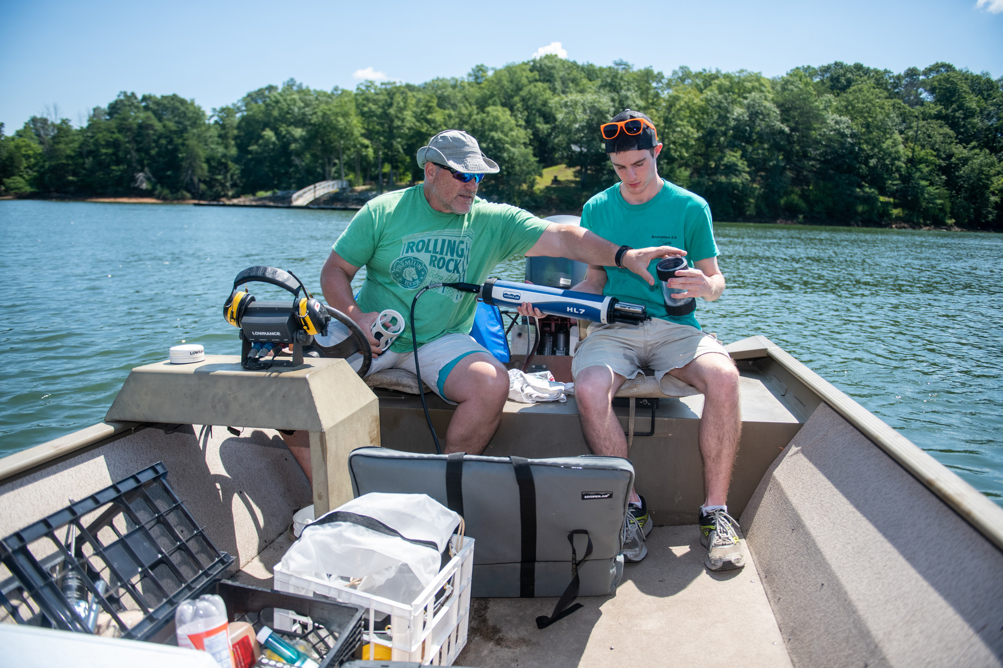 Student and professor look upstream for the dirt on Leesville Lake