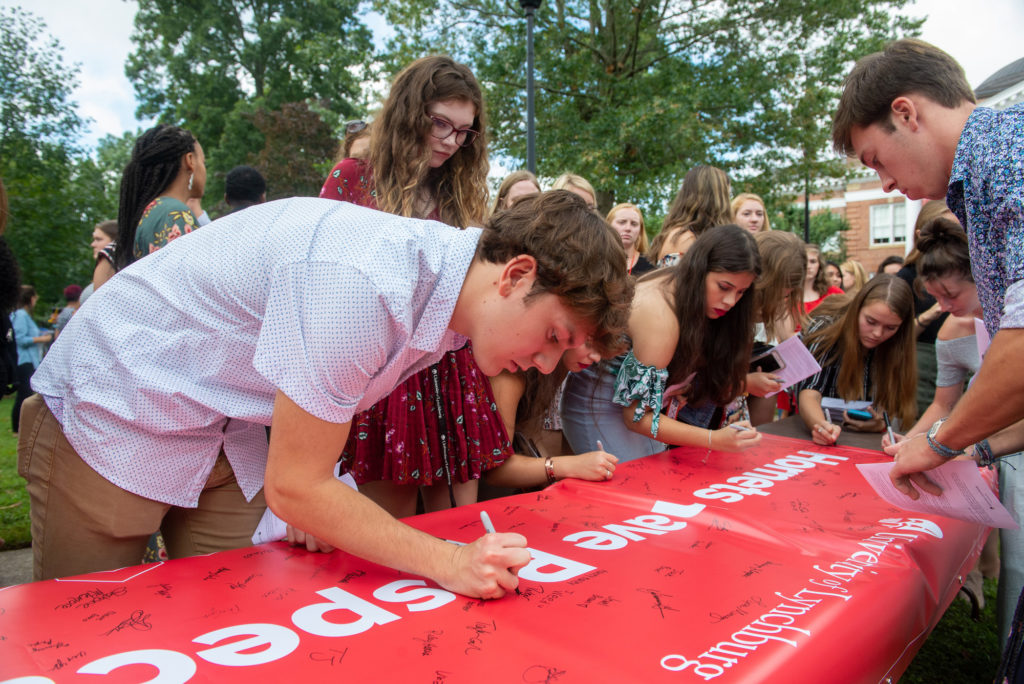 Students sign respect banner