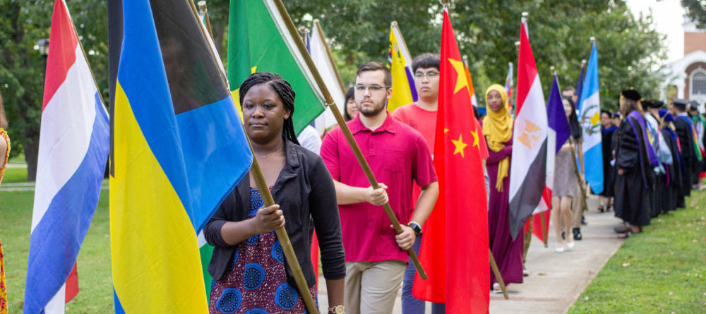 Students carry flags in at Convocation