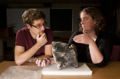 Brooke Haiar talking about a fossil with a student.