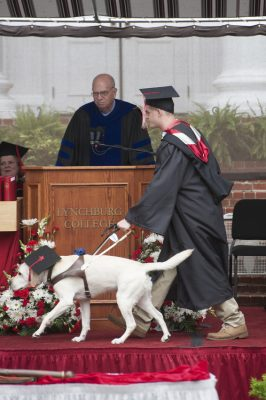 John Pastorius at Commencement with his guide dog, Houston.