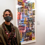Frankie Slaughter stands beside her artwork spring 2020