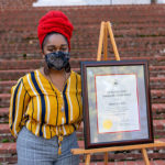 Ashani Parkers stands by her Sommerville Scholar certificate