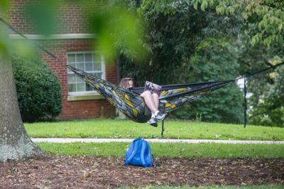 Student in hammock with laptop