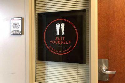 Suit Yourself sign on door