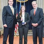 Kara Swankowski, Class of 2012, receives the Collaboration Award from Department of Justice representatives.