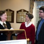 Annette Evans, Amy Merrill Willis, and Stephen Dawson stand in a room.