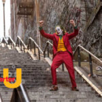 Image from the Joker movie showing the joker dancing down concrete steps. The logo for A Smarter U shows in the foreground