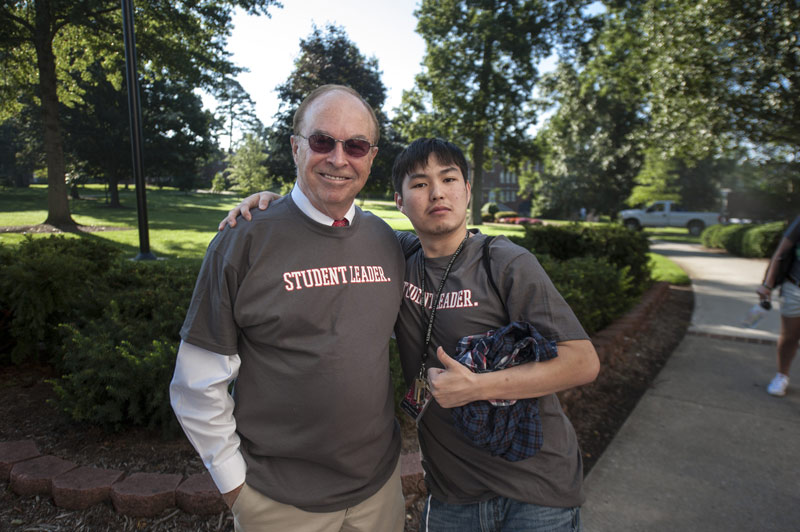 Dr. Garren with a student during the Leadership Summit