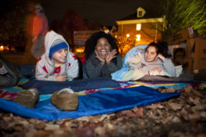 Three University of Lynchburg students camping out on the Dell at night