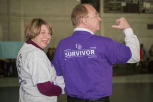 Mrs. Sheila Garren with President Garren wearing a purple Relay for Life t-shirt