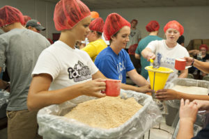 University of Lynchburg students volunteering in food service