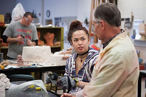 Professor Richard Pumphrey in the sculpture studio with a student