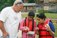 Dr. Tom Shahady and two graduate students investigating water quality