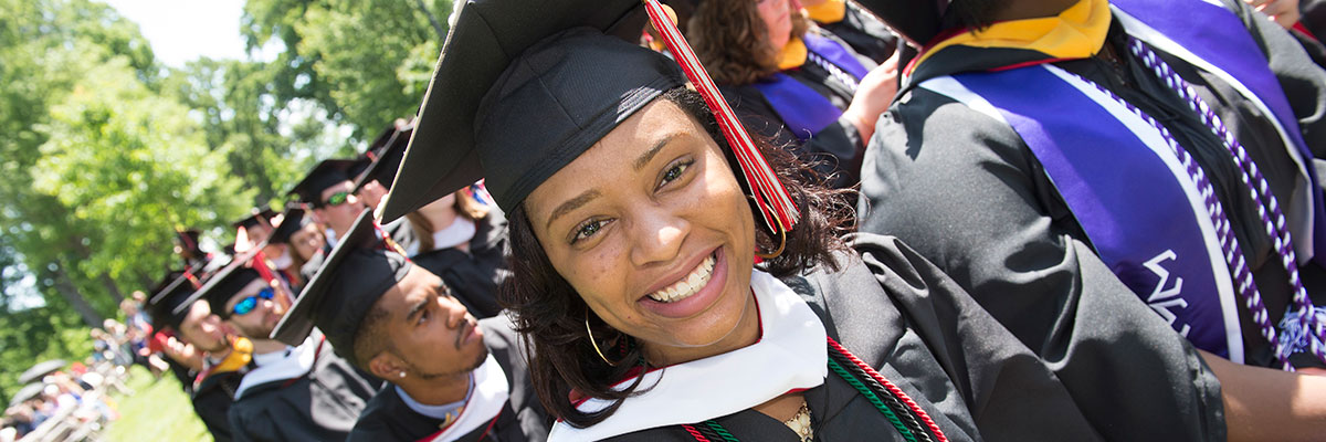 Student smiling at Commencement ceremony