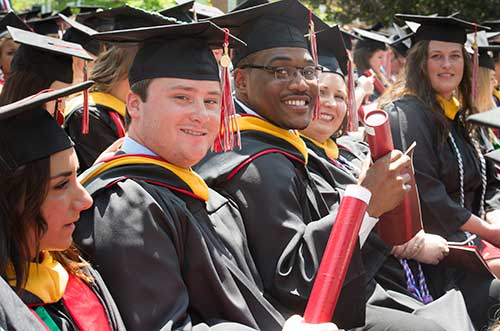 Group of students in cap and gown at Commencement exercises