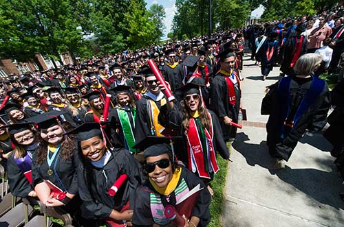 Overhead photo of seniors in cap and gowns outside on the Dell