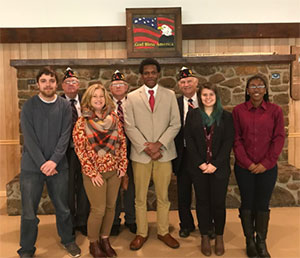 Group photo of participants with Dr. Youra at Debate & Forensics event