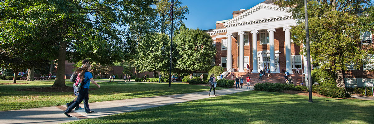 Students walking outdoors on the University of Lynchburg campus
