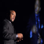 Daymond John speaking on stage