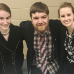 three debate team members, Rhiannon, Justin, and Chelsea