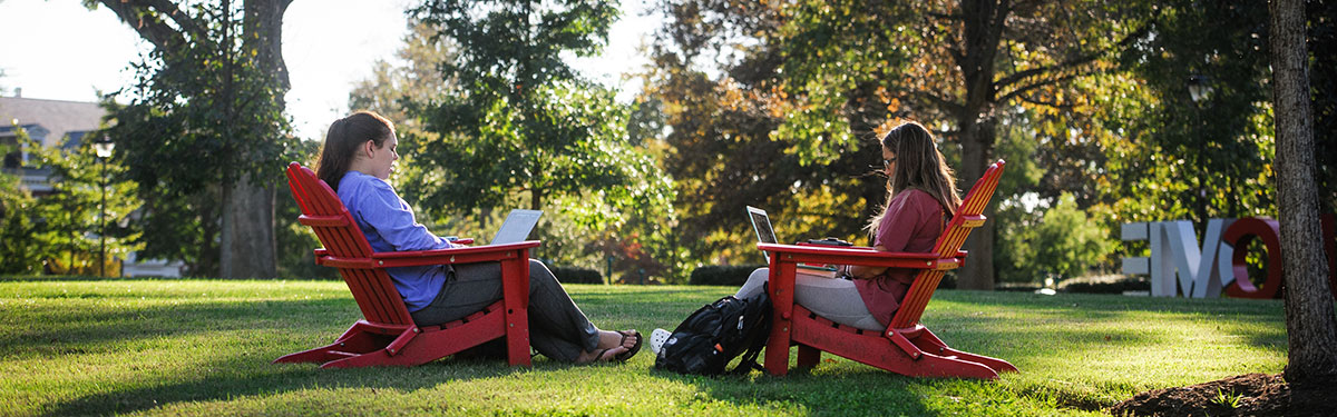 Two students in red chairs on the Dell